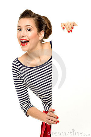 Attractive young woman holding blank poster