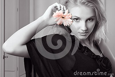 Attractive young woman holding gerbera
