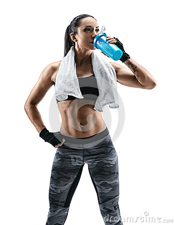 Free Attractive Young Woman In Sports Wear And With Towel On Shoulders Drink Protein Cocktail In Special Shaker Royalty Free Stock Image - 90396236