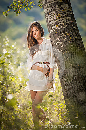 Free Attractive Young Woman In White Short Dress Posing Near A Tree In A Sunny Summer Day. Beautiful Girl Enjoying The Nature Royalty Free Stock Images - 48367969