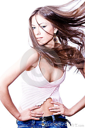 Attractive young woman with long hair blown
