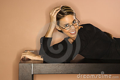 Attractive Young Woman Looking Over Her Glasses Sm