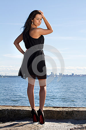 Attractive young woman on the pier