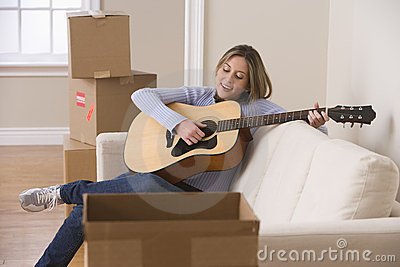 Attractive Young Woman Playing the Guitar