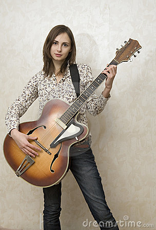 Free Attractive Young Woman Playing Guitar Stock Images - 7298874