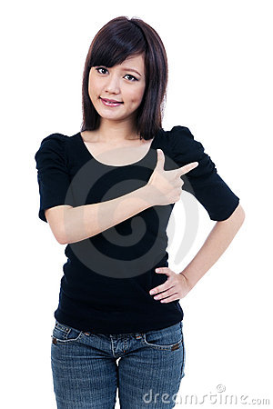 Attractive young woman pointing at copy space