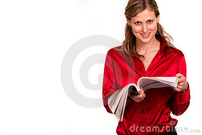 Attractive young woman reading magazine