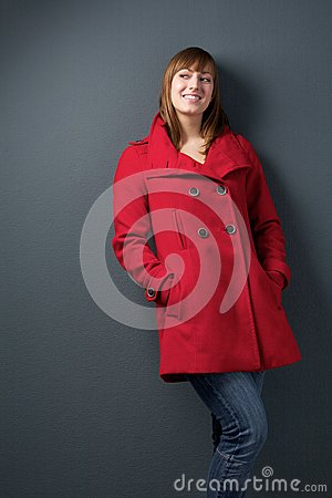 Attractive young woman in red jacket