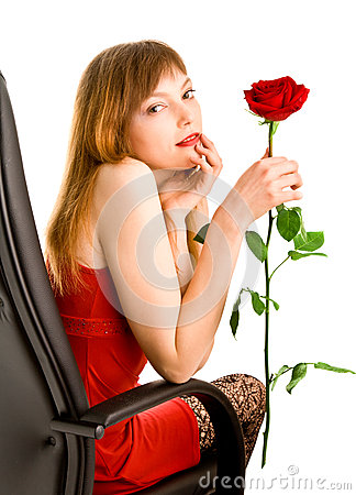 Attractive young woman with red rose
