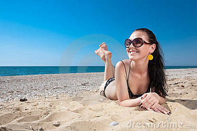 Attractive young woman at the sea