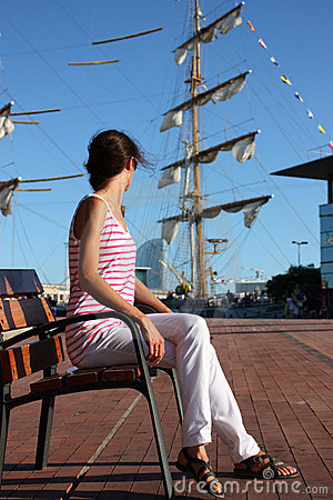 Attractive young woman in a sea port