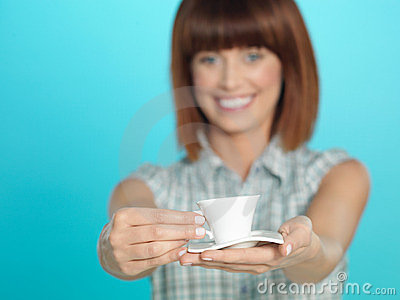 Attractive young woman showing an espresso coffee