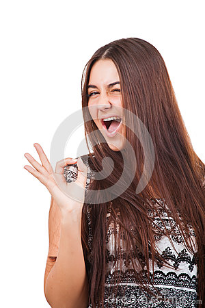 Attractive young woman showing ok sign
