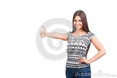 Attractive young woman shows thumb up sign