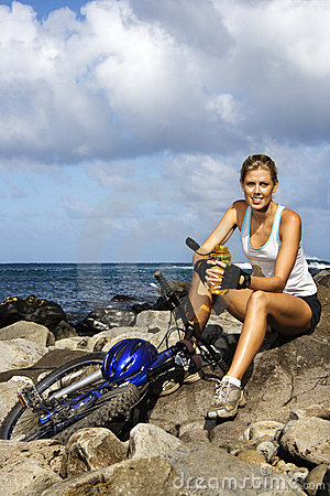 Attractive Young Woman Sitting With Bicycle