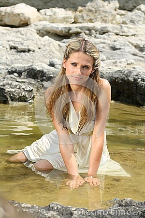 Attractive young woman sitting in the water