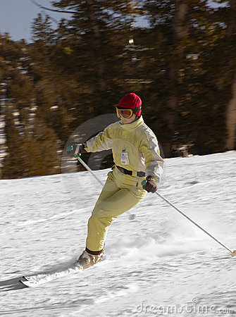 Attractive young woman skiing