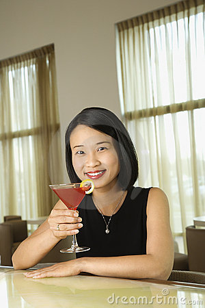 Attractive Young Woman Smiling with Beverage