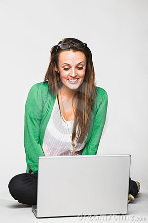 Attractive young woman smiling with laptop