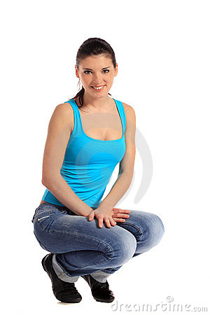 Attractive young woman in squatting position