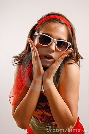 Attractive young woman wearing sun glasses