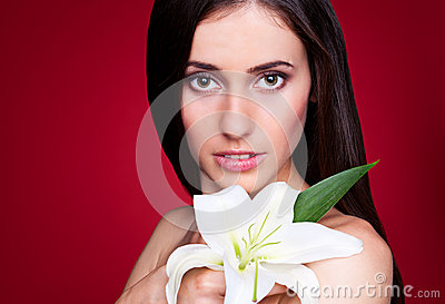 Attractive young woman with white lily