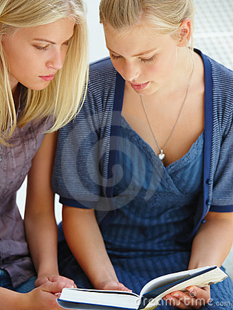 Attractive young women reading book