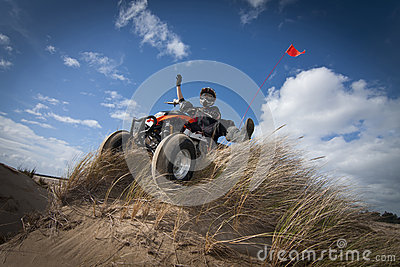 ATV on grassy sand dune