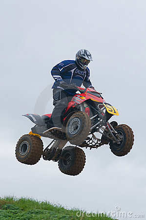 ATV Motocross Rider Over a jump Editorial Stock Image