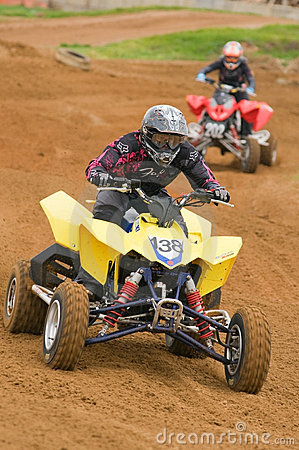 ATV Motocross Rider racing down the straight Editorial Stock Image