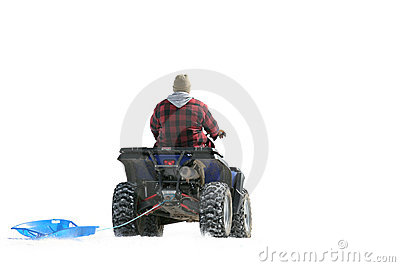 ATV on snow pulling sled