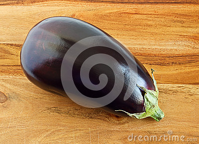 Aubergine, Indian purple eggplant on wood