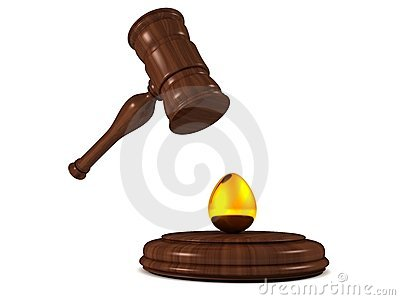 Auction gavel hammer with golden egg