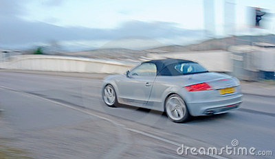 Audi sports car with motion blur.