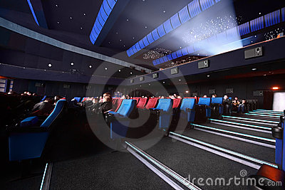 Audience sit in cinema and wait showtimes