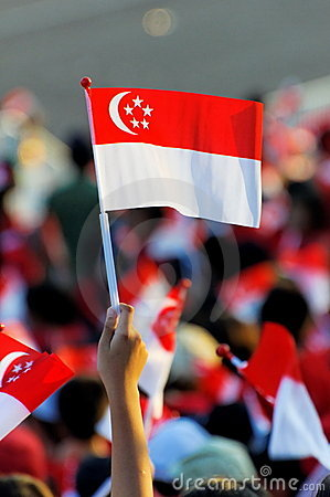 Audience waving Singapore flag during NDP 2009 Editorial Photo