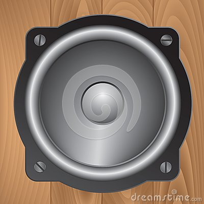Audio speaker on wooden background