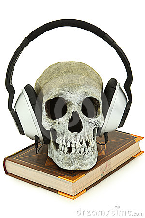 Audiobook Concept Human Skull with Headset on Book