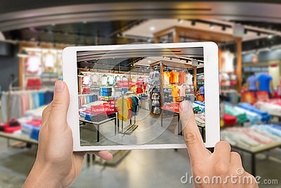 Augmented reality marketing concept. Hand holding digital tablet Stock Photo