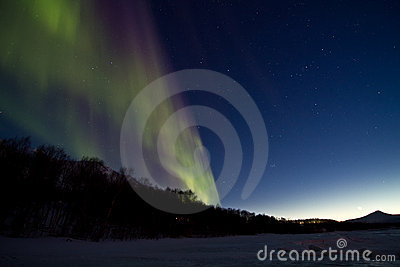 Aurora northern light over the winter sea ice