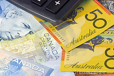 Australia and Canadian currency with calculator