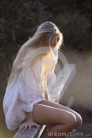 Free Australian Beauty With Long Blond Hair Looks Down With Sun Streaming Through Hair Royalty Free Stock Photo - 52489555