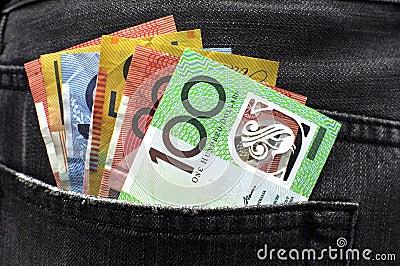 Australian money in jeans back pocket