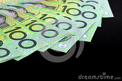 Australian One Hundred Dollar Bills over Black