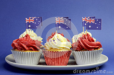 Australian theme red, white and blue cupcakes with national flag.