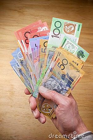Australijczyka gotówki ręka