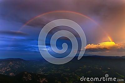 Austria Alps with rainbow