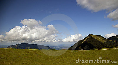 Austrian Alps with blue sky and puffy clouds