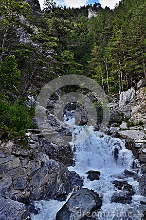 Austrian Alps-mountain stream over the city Pfunds