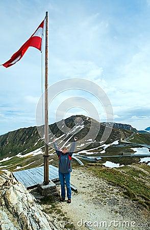 Austrian Flag above Alps mountain